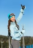 Half-length portrait of female skier thumbing up Royalty Free Stock Image