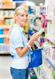 Half length portrait of girl at the market choosing cosmetics Royalty Free Stock Photography