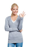 Half-length portrait of girl okay gesturing Stock Images