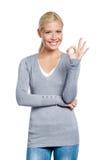 Half-length portrait of girl okay gesturing Stock Images