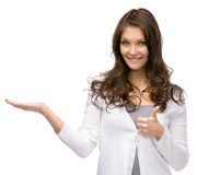 Half-length portrait of girl with palm up and thumbing up royalty free stock photography