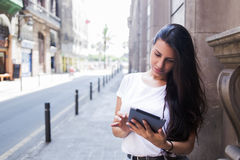 Half length portrait of a gorgeous female tourist using digital tablet computer for navigation during summer trip Stock Image