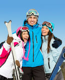 Half-length portrait of group of embracing downhill skier friends Royalty Free Stock Photo