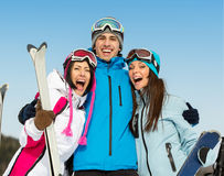Half-length portrait of group of embracing skier friends royalty free stock photo