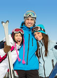 Half-length portrait of group of hugging skier friends Royalty Free Stock Photography