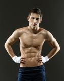 Half-length portrait of half naked boxer Royalty Free Stock Image