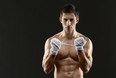 Half-length portrait of hand wrapping fighter Stock Images