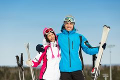 Half-length portrait of hugging downhill skiers Stock Images