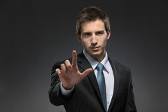 Half-length portrait of man forefinger gesturing Stock Photos