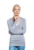 Half-length portrait of pensive woman Stock Photo