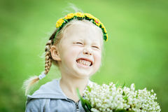 Half length portrait of smiling baby girl with spring flowers stock images