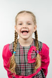 Half-length portrait of a smiling girl four years. Half-length portrait cheerful fun girl four Europeans Royalty Free Stock Photo