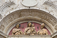 Half length portrait statues above the Church. Depiction of three statues on the top of the door of a church in Montepulciano Stock Images