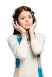 Half-length portrait of teenager listening to music Stock Images