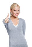 Half-length portrait of thumbing up lady Stock Photo