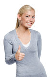 Half-length portrait of thumbing up woman Stock Image