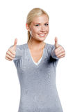 Half-length portrait of thumbing up girl Royalty Free Stock Images