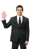 Half-length portrait of waving hand businessman. Isolated on white. Concept of leadership and success royalty free stock images