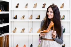Half-length portrait of woman keeping high heeled shoe Royalty Free Stock Images
