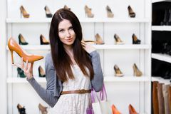 Half-length portrait of woman keeping stylish pump Royalty Free Stock Images