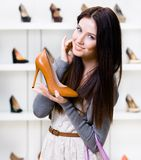 Half-length portrait of woman keeping stylish shoe Royalty Free Stock Images