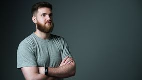 Half length portrait of young bearded hipster man looking at blank copy space stock video footage