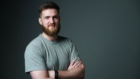 Half length portrait of young bearded hipster man smiling at camera stock video footage