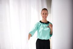 Half length portrait of a young cheerful successful businesswoman dressed in classic elegant clothes posing Royalty Free Stock Photography