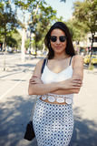 Half length portrait of a young stylish hipster girl dressed in trendy clothes posing while standing in urban setting Royalty Free Stock Photography