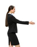 Half-length profile of businesswoman handshaking. Half-length profile of businesswoman handshake gesturing, isolated on white. Concept of leadership and stock image