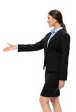 Half-length profile of female manager handshaking. Half-length profile of businesswoman handshake gesturing, isolated. Concept of leadership and cooperation royalty free stock photography