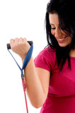 Half-length view of female exercising with rope Stock Photography