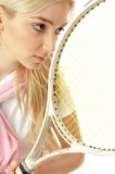 Half length view of female playing tennis Stock Images