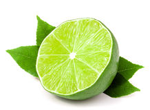 Half a lime with leaves isolated on white background Royalty Free Stock Photo
