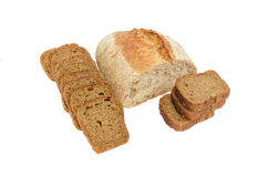 Half loaf of wheat unleavened bread and sliced brown bread Stock Images