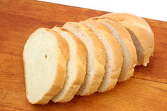 Half loaf of white wheat bread. On a cutting board Royalty Free Stock Photos