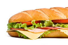Half of long baguette sandwich. With lettuce, tomatoes, ham, turkey breast and cheese Stock Image
