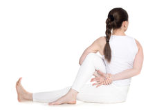 Half lord of the fishes yoga pose Royalty Free Stock Image