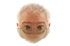 Half male face in mirror Stock Photography