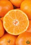 Half of mandarin Stock Images