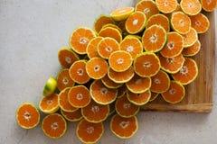 Half of mandarines on table Royalty Free Stock Image