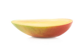 Half of a mango fruit isolated Stock Images