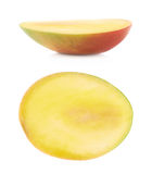 Half of a mango fruit isolated Royalty Free Stock Images