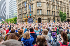 HALF MARATHON in Manchester, UK. MANCHESTER, ENGLAND - 28 MAY, 2017: Athlets are doing warming up before the HALF MARATHON in Manchester, UK royalty free stock images
