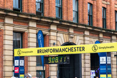 HALF MARATHON in Manchester, UK. MANCHESTER, ENGLAND - 28 MAY, 2017: Signs on THE STREETS FOR HALF MARATHON in Manchester, UK stock image