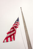 Half mast American flag concept a symbol of the United States. Half mast American flag concept as a symbol of the United States flying at low level to honor Stock Photos