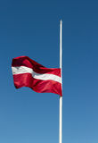 Half-mast flag. Royalty Free Stock Images