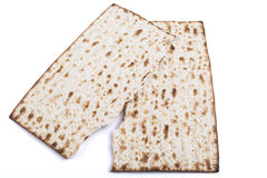 Half Matza. Broken  Jewish traditional Pesach textured Matza bread substitute isolated on white background Royalty Free Stock Images