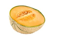 A half of melon. Isolated on the white background royalty free stock photo