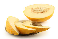 Half of melon and a plate Royalty Free Stock Photography